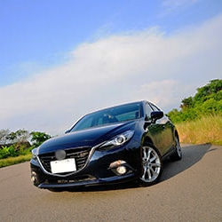 Mazda sedan on road