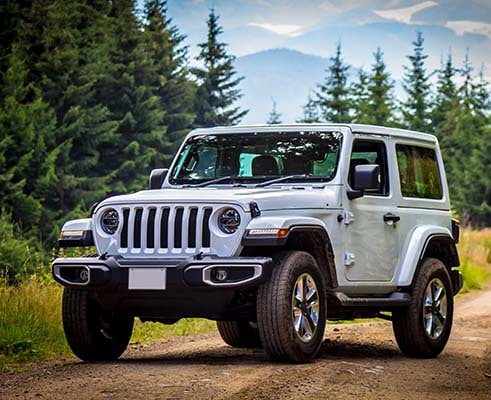 Jeep Wrangler on dirt road
